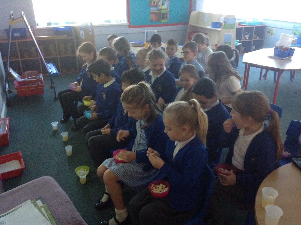 Children enjoying their popcorn.