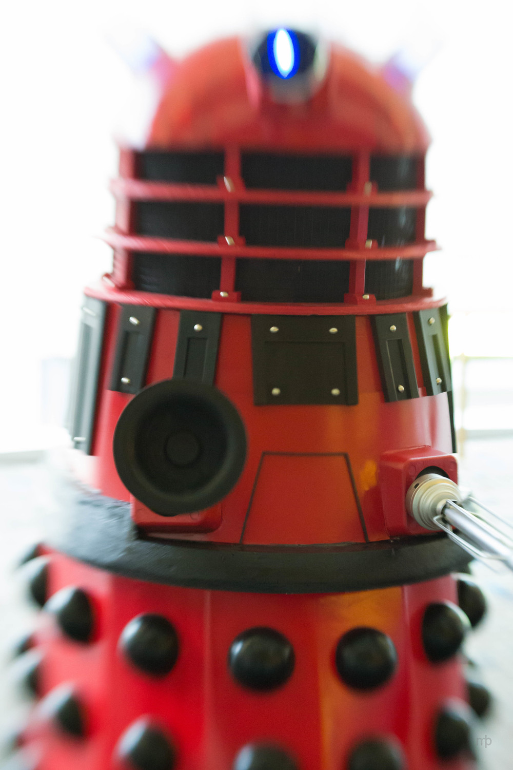 Red Dalek cosplay.  Taken at Planet Comicon 2014.