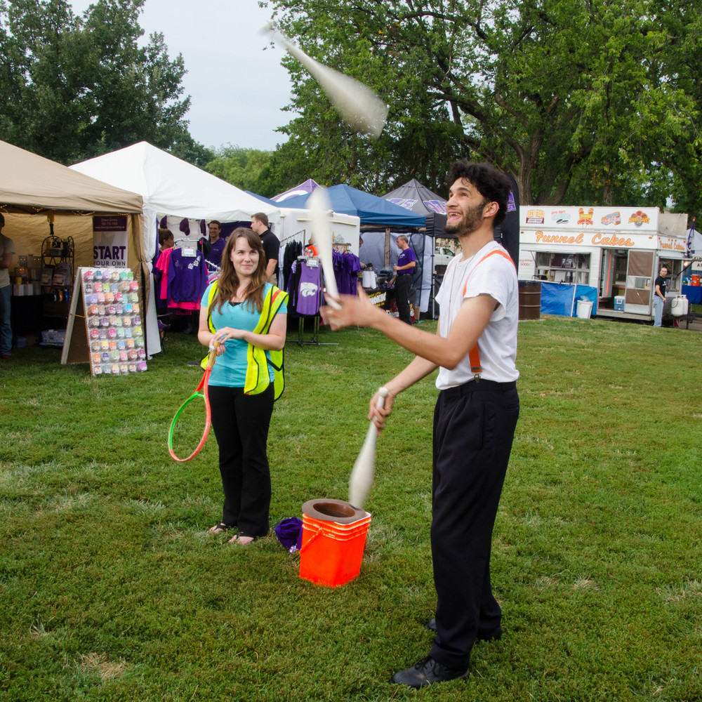 Juggling Street Performer.  Purple Power Play in the Park 2014