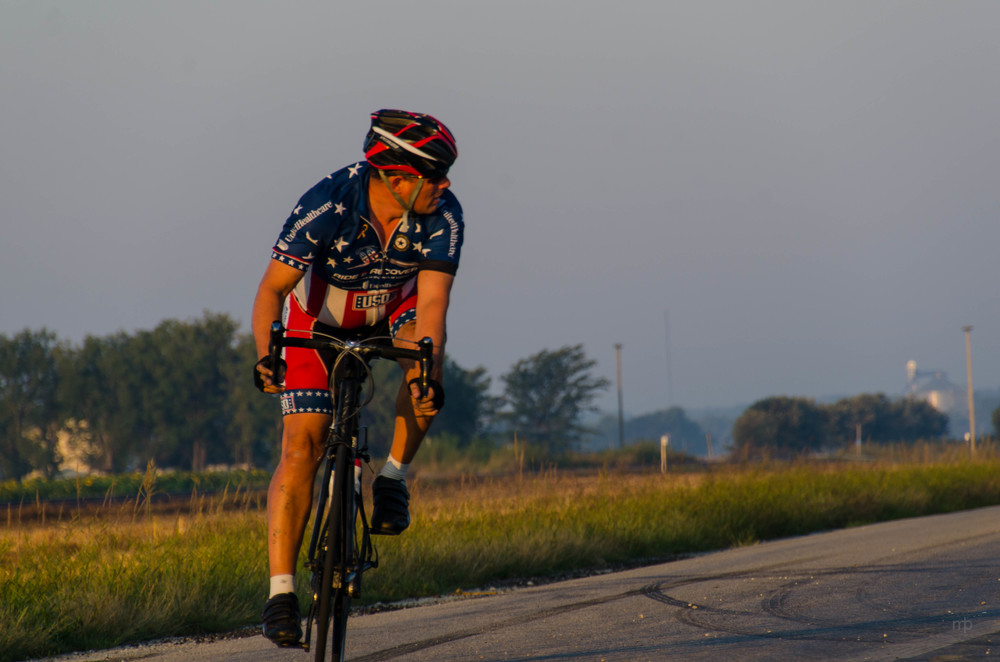 Yellow Brick Road Bike Rider.  Nikon D7000, Tamron 18-270, ISO100, 200 mm f/8.0, 1/160 sec