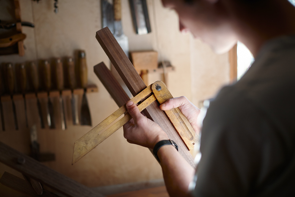 editorial detail photograph of woodworker in his shop