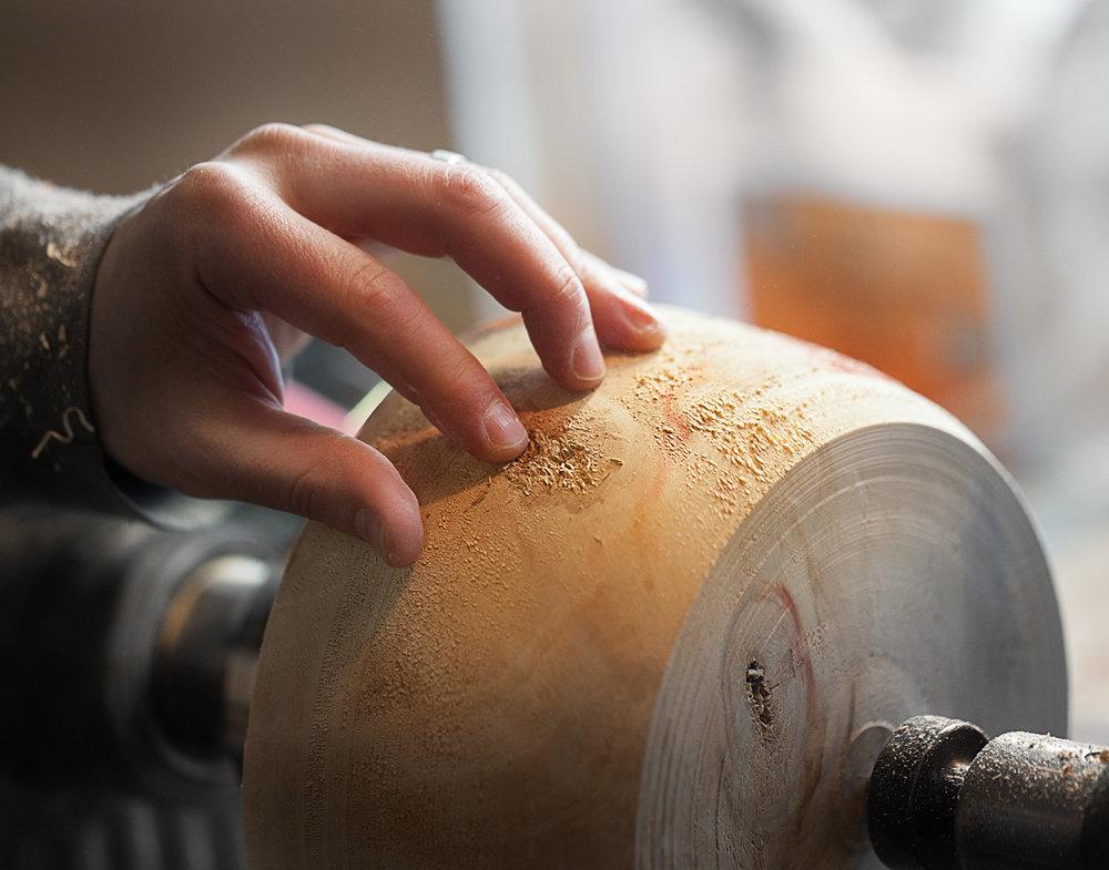 hands sanding wood