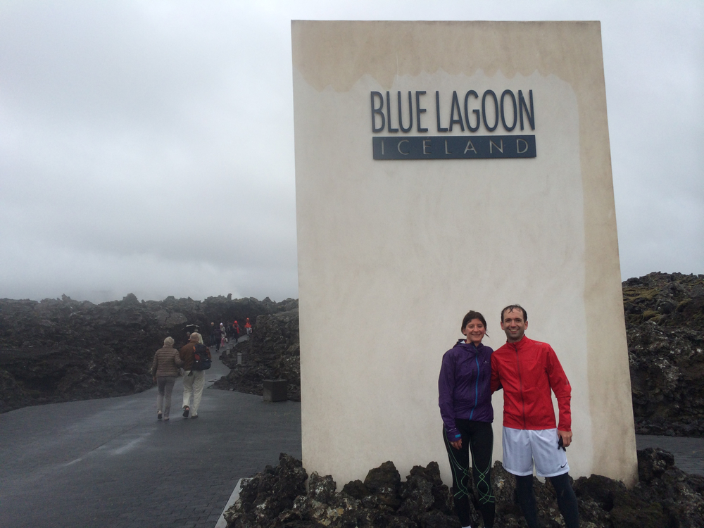 Standing in front of a big Blue Lagoon badge
