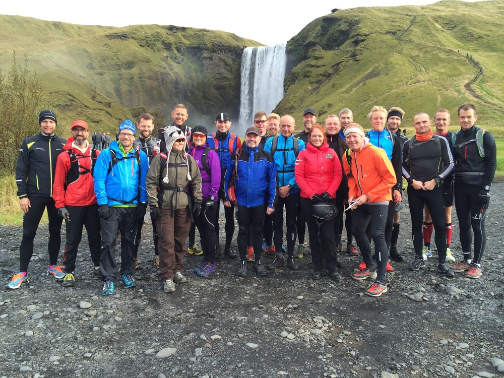 A running group in front of Skógarfoss