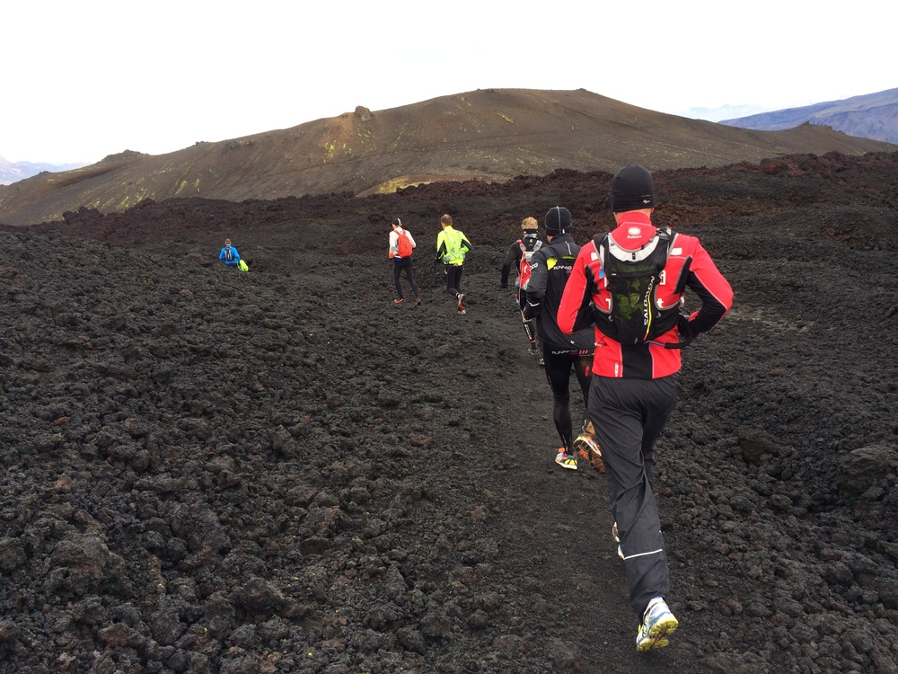 A group running on a lava field trail
