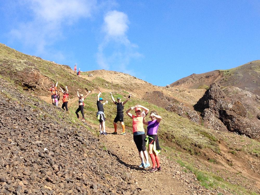 Runners waving in Reykjadalur