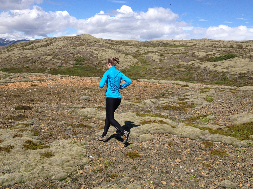 Running in a mossy and barren landscape