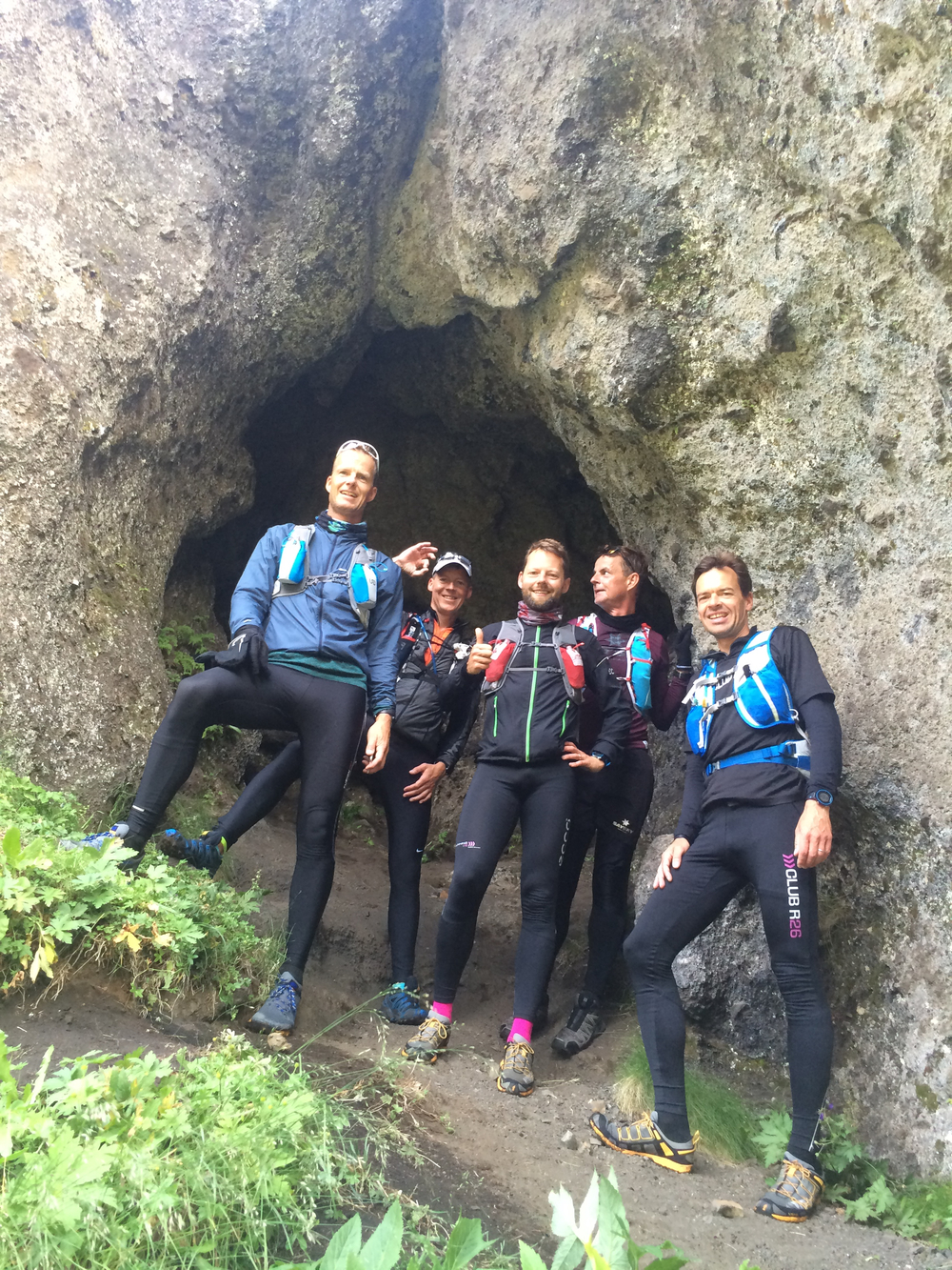 Runners relaxing in front of a Cave