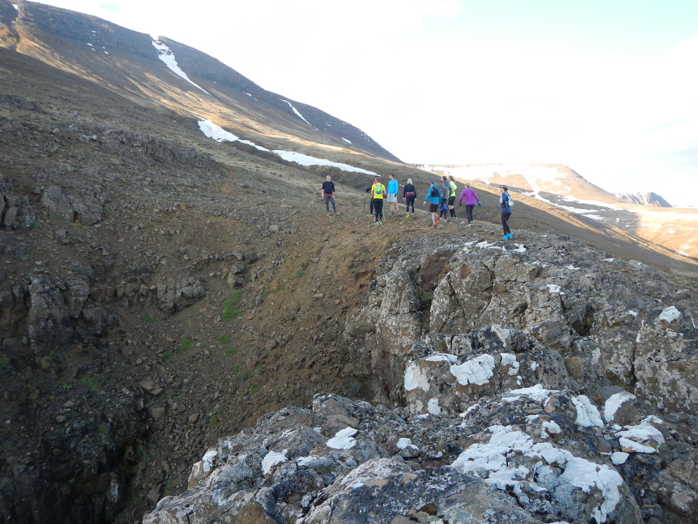 A running group looking upwards in Mt. Esja