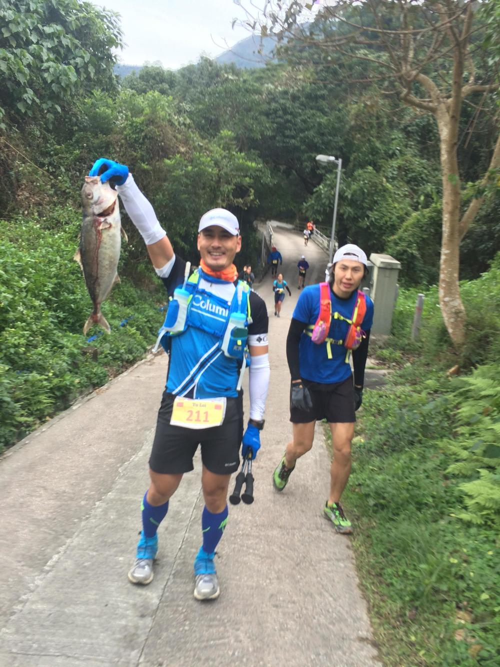 Runner holding a fish.jpg
