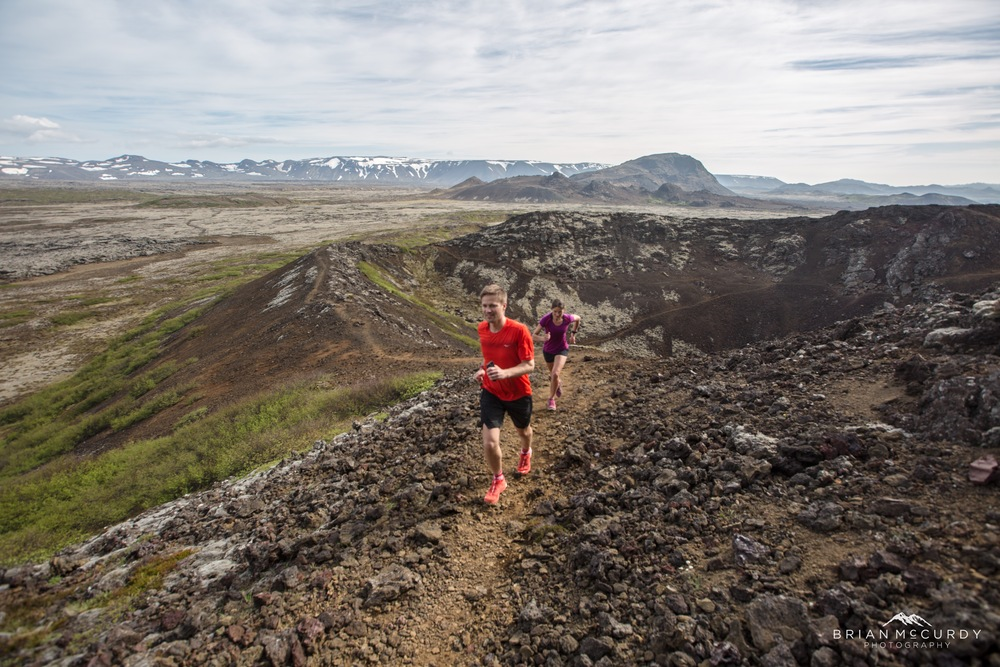 Running with a crater in the background