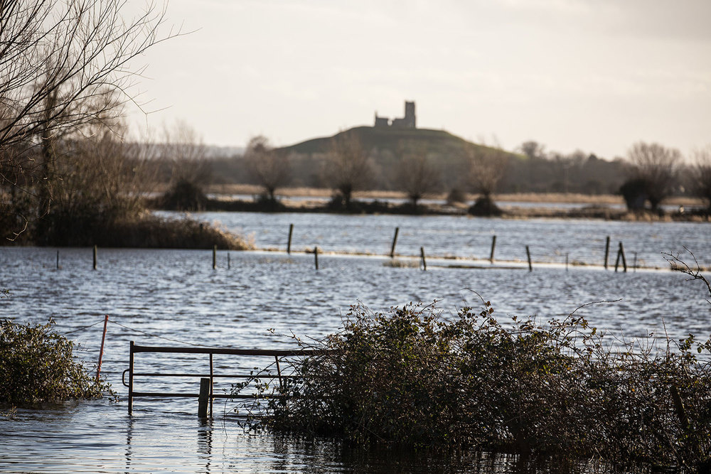 Floodwaters in the fields around Burrow Mump