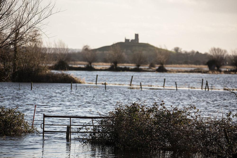 Floodwaters in the fields around Burrow Mump