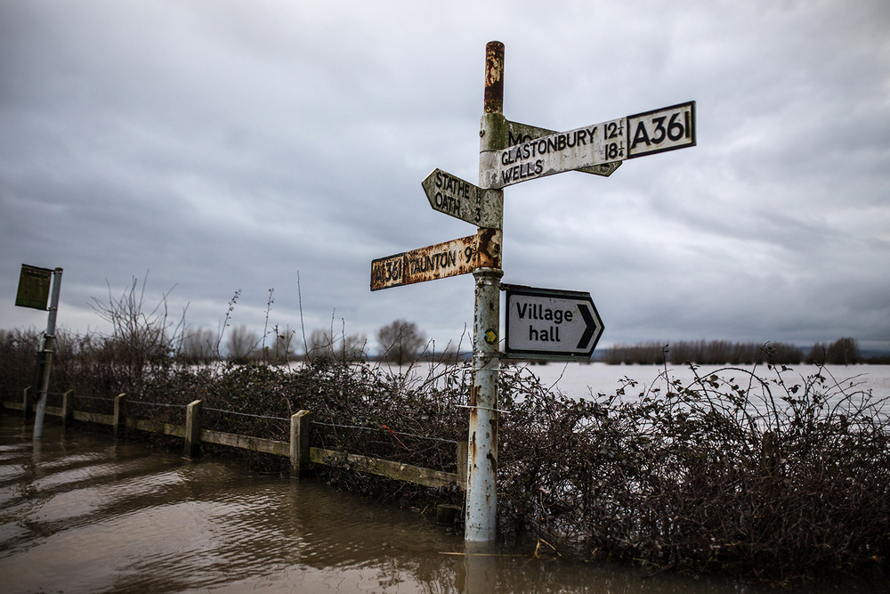 Signpost surrounded by floodwater, Burrowbridge