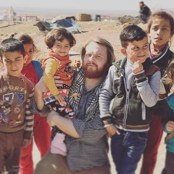 - 2017 Iraq, pictured with Yazedi kids 5 miles from Mosul.