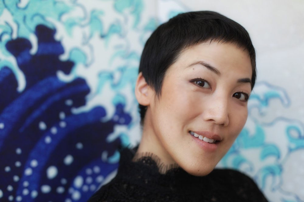 traci kato-kiriyama is an award-winning artist, community organizer, and cultural producer.  In community - traci is the Director/Co-Founder of Tuesday Night Project (presenter of art+community series, Tuesday Night Cafe, in its 21st year and the longest-running Asian American mic series in the country). She is also a steering committee member of the VigilantLOVE Coalition, working against Islamophobia and for safety through solidarity and healing initiatives.  In career - traci is an actor and principal writer for PULLproject Ensemble, and has received recognition from several institutions and juries including two consecutive national grant awards from the Network of Ensemble Theaters. Their current show in development, Tales of Clamor, is both a call to action and an analysis of silence & the collective clamor necessary to show up for self and other in the name of solidarity, safety, and justice. Tales of Clamor will have its world premiere in February of 2019 in Downtown Los Angeles. Recently, she was the springtime Teaching Artist-in-Residence for Grand Park and Artist in Residence for NeighborWorks America. She was the Artist-in-Residence for the AARC at Pomona College and was a guest lecturer for three years at Pitzer College, focusing on creative, counseling, and community paths in radical wellness & healing. Through each year for over the last two decades, she has toured to hundreds of venues throughout the country as a performer/actor, writer, theatre deviser & collaborator, writing/storytelling and ensemble performance facilitator, educator, speech & speaking coach, cultural producer, and artist-in-residence [Presenters include The Getty Foundation (L.A.), Skirball Cultural Center (L.A.), The Smithsonian (D.C.), The Ford Amphitheater Inside The Ford (L.A.), LaMaMa Cabaret (NYC), Yerba Buena Center for the Arts (San Francisco), Asian Arts Initiative (Philadelphia), EnWave Theatre (Toronto)]. Her writing and commentary have been featured by numerous print and online publications including Elle.com for Melissa Harris-Perry; The Hollywood Reporter; Entropy; Regent Press; The Rafu Shimpo; Heyday Books; Tia Chucha Press; Chapparal Canyon Press; Bamboo Ridge Press. Her forthcoming book of writing & poetry will be released by Writ Large Press in 2019.