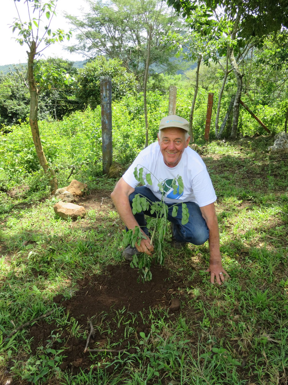 Board Member and Rotarian Ray Finney planting a tree in rural Nicaragua.