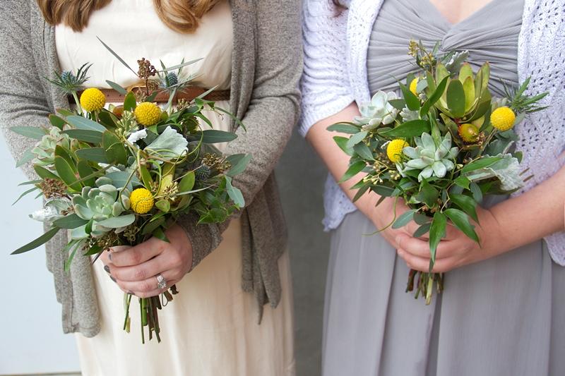 Mismatched bridesmaids holding natural bouquets