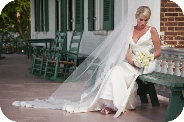 bride sitting on the front porch at Carnton Plantation