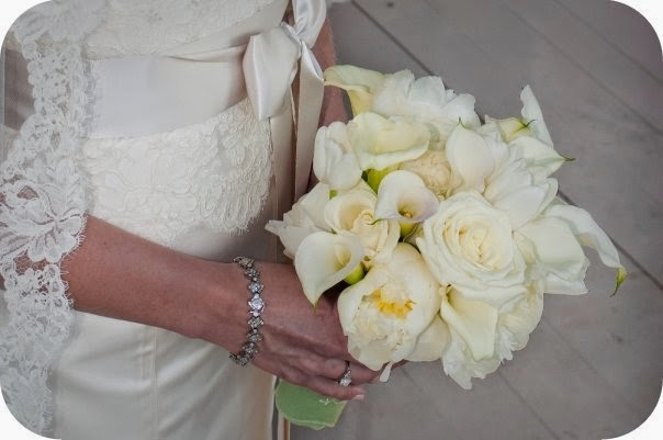 bride bouquet with calla lillies, roses and peonies