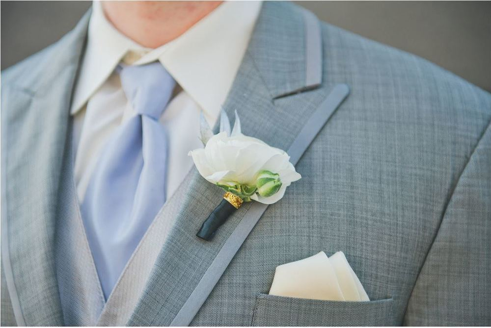 Groom gray suit white boutonniere