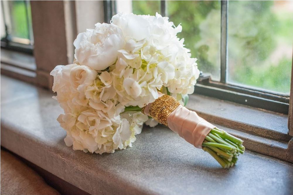 all white wedding bouquet gold ribbon