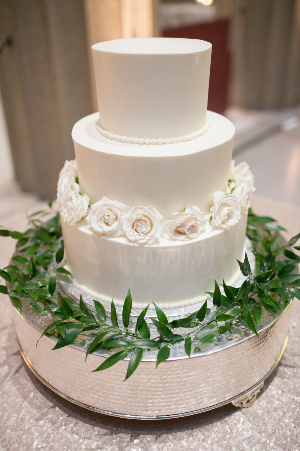 White 3 tier cakes with roses and greenery (Hannah Elaine Photography)