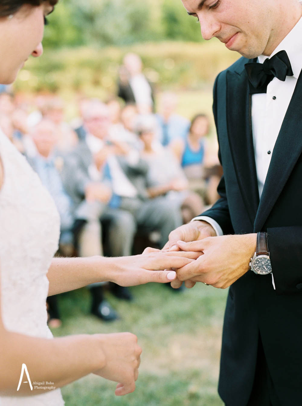 bride and groom exchanging rings during ceremony