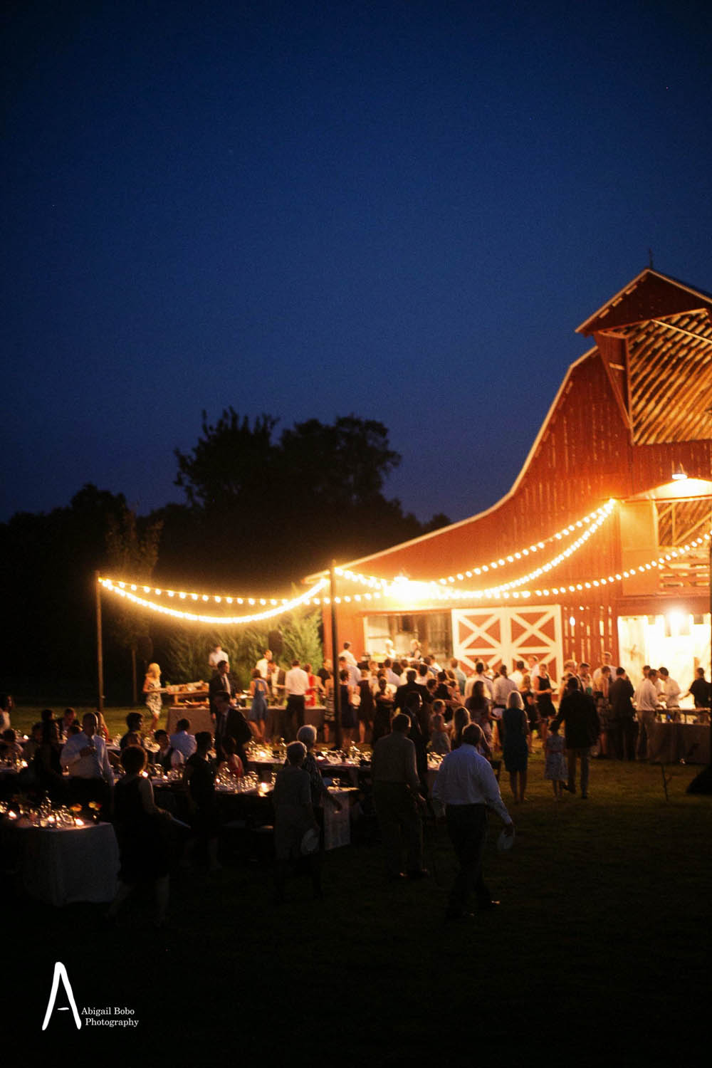 large red barn with string lights