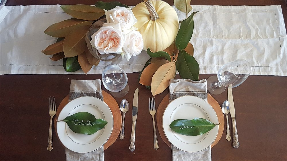 tablescape white pumpkin and magnolia leaves.jpg