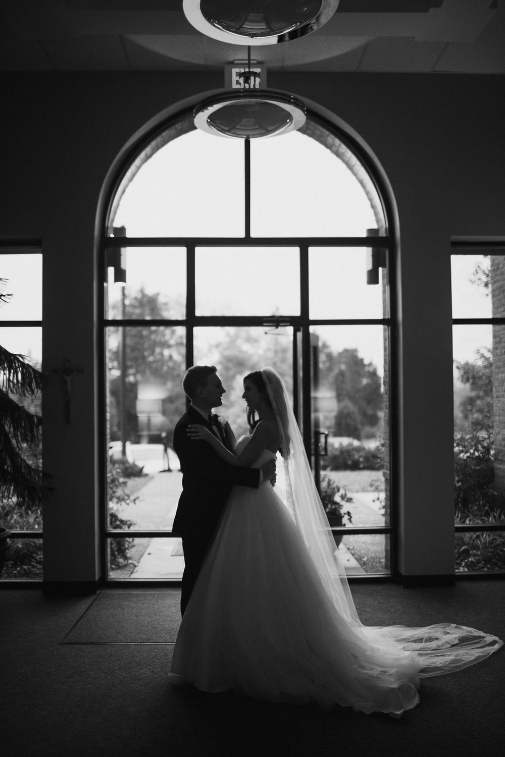 black and white bride and groom hugging