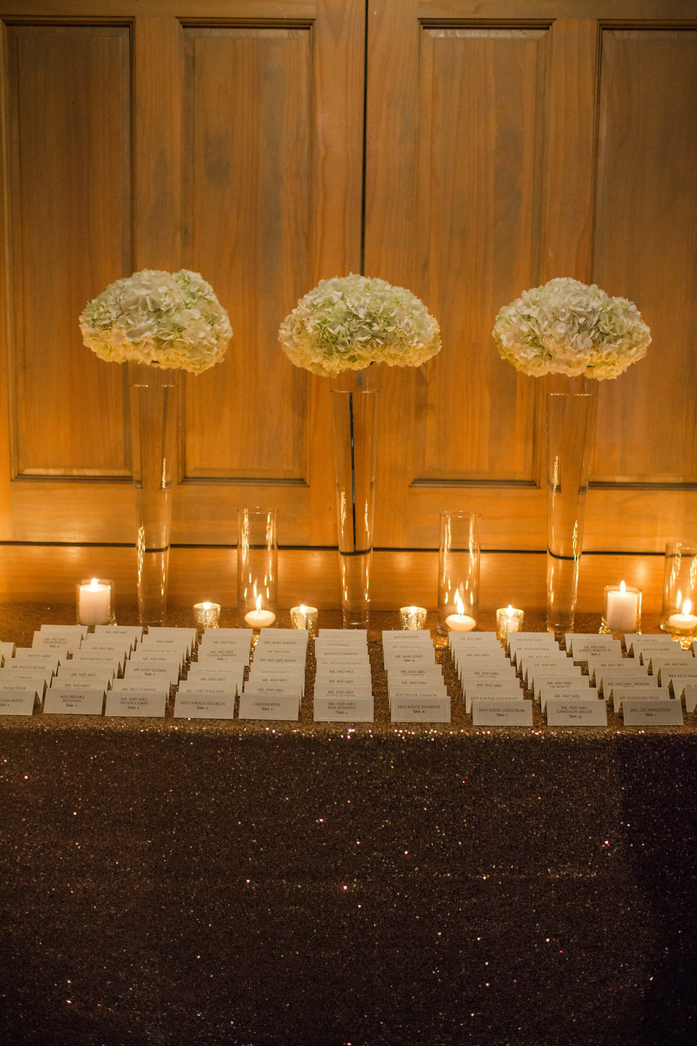 escort table with candles and white flowers