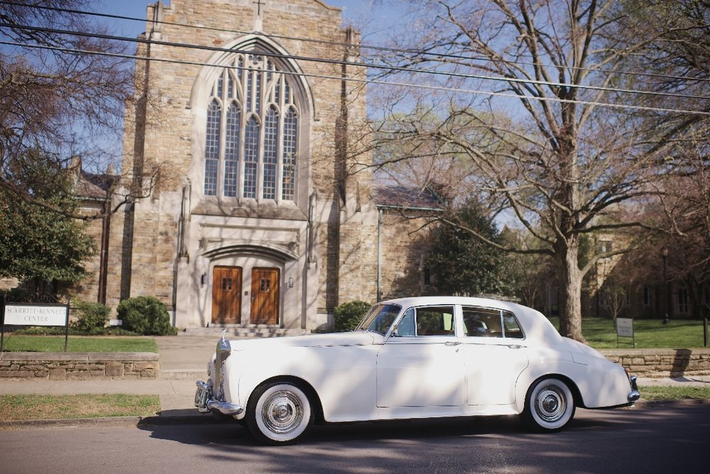classic car outside church.jpeg