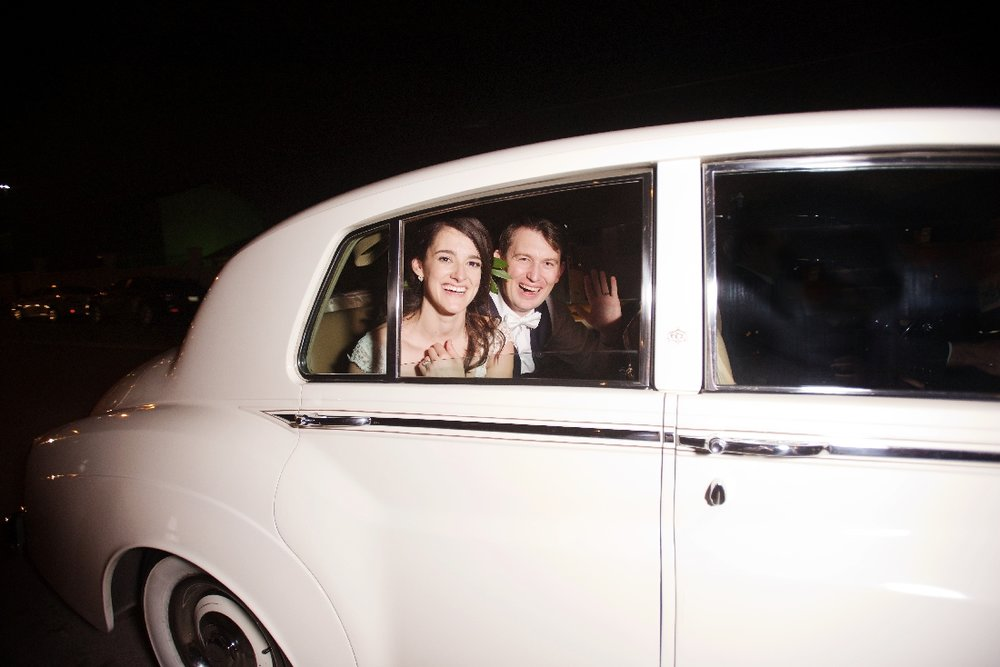 bride and groom in classic car.jpeg