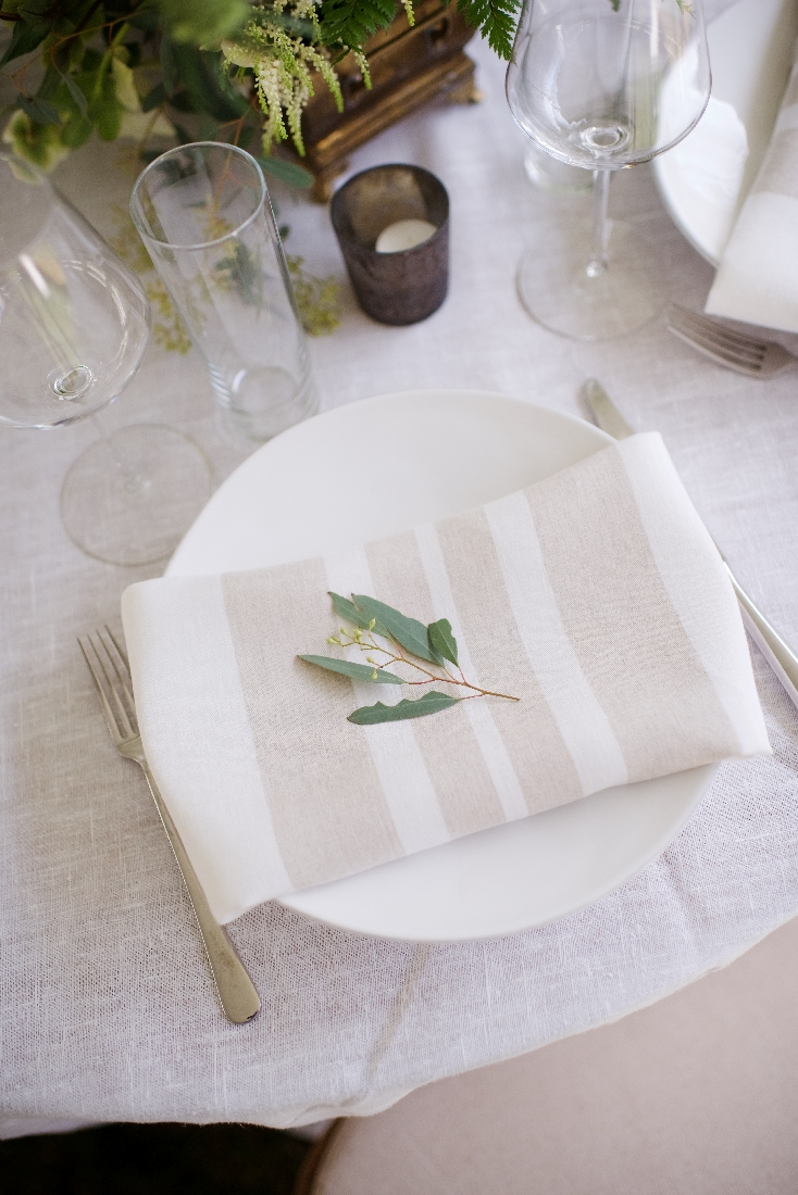 reception table with stripe napkins greenery.jpeg