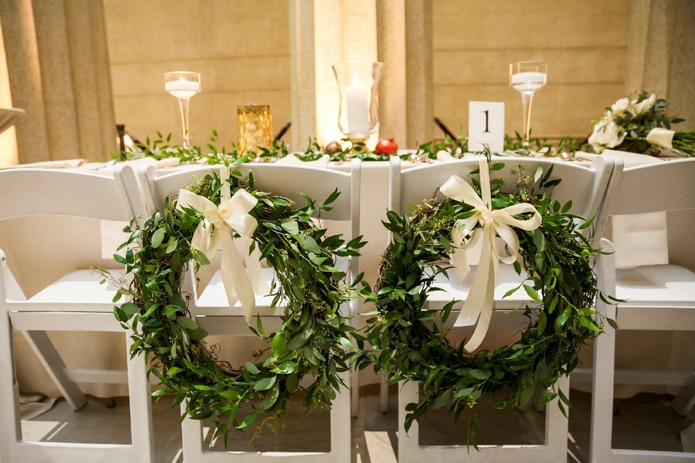greenery wreath on chairs.jpeg