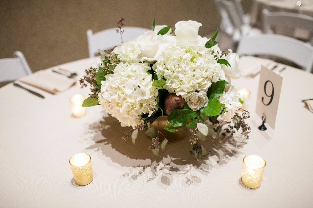white centerpiece reception.jpeg