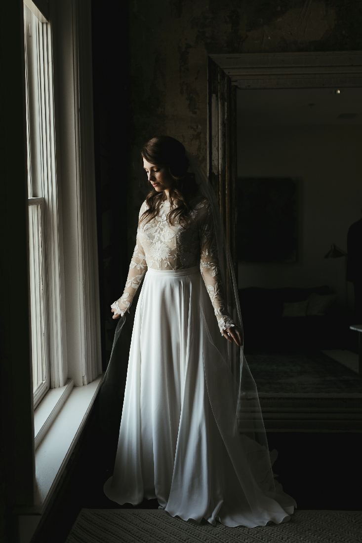 bride standing by window.jpeg