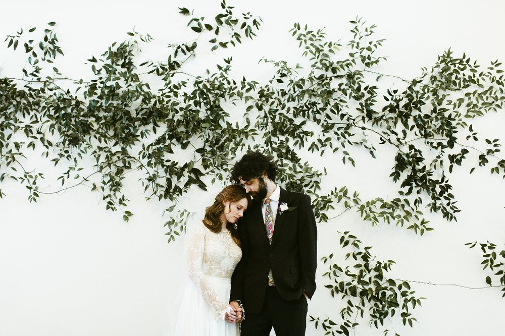 greenery wall wedding couple.jpeg