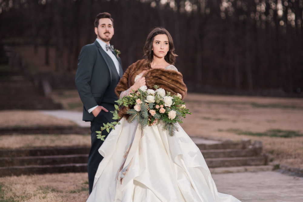 winter bride and groom outside