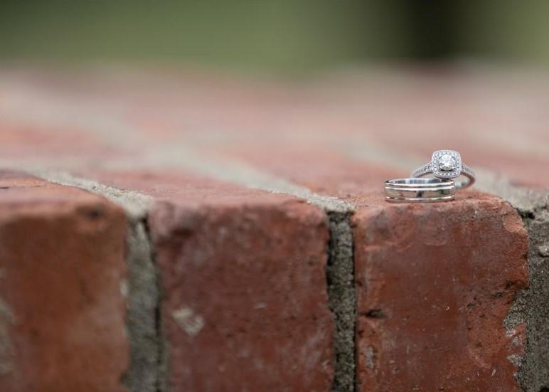 wedding rings on bricks