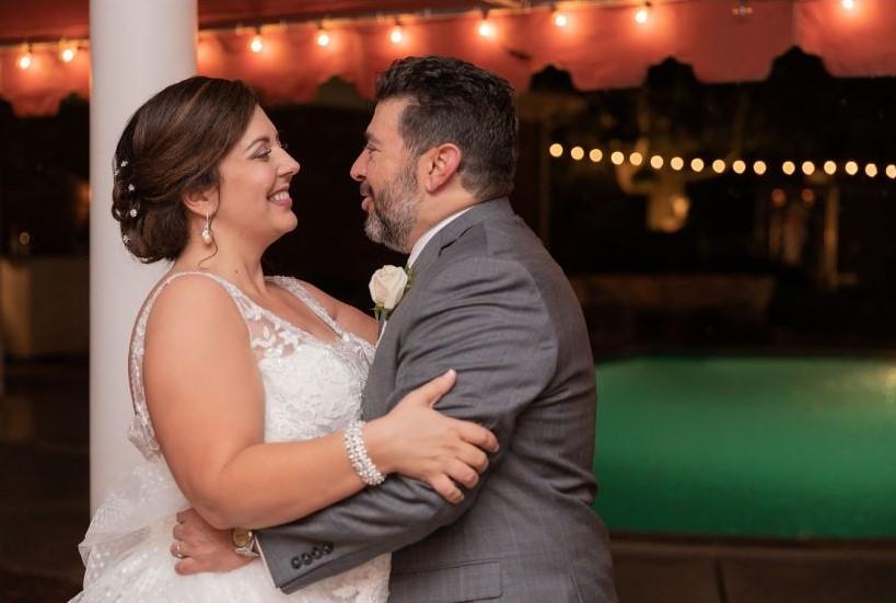 bride and groom on patio by pool.JPG