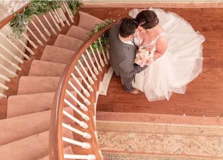 bride and groom at bottom of stairs.JPG