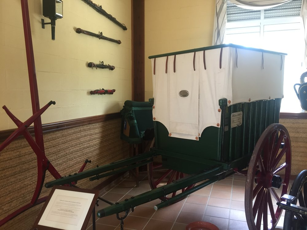 "The Cartusian Monks donated this ""Tartana"" light carriage from the 20th century. It was used for daily work, but you can see the very small window that allowed them to see out, while remaining ""cloistered"" from the outside world."