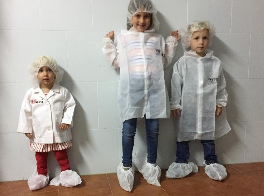 Seriously, is there anything cuter than kids ready to tour a meat processing plant?