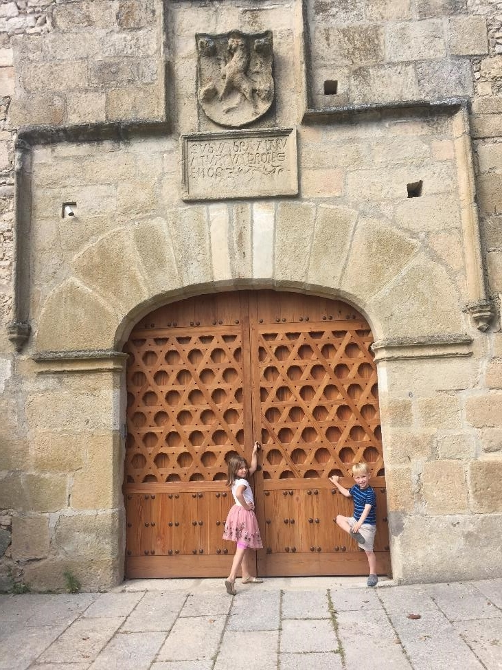 "This door is part of the defensive structure in Trujillo, built between the 13th and 15th centuries to protect the main route into the city following the expulsion of the Moors. Above the door, it reads ""Protect me like the pupils of your eyes; hide me in the shade of your wings,"" Samuel 16:8."