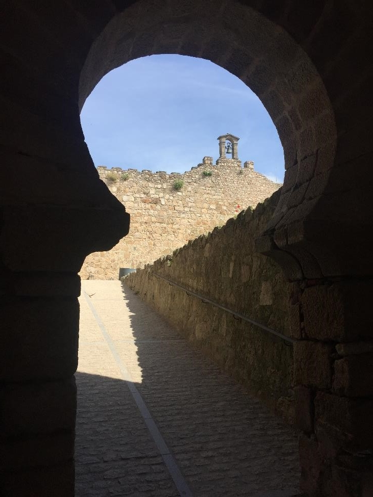 A glimpse into the Trujillo Castle through a Moorish-syle doorway.