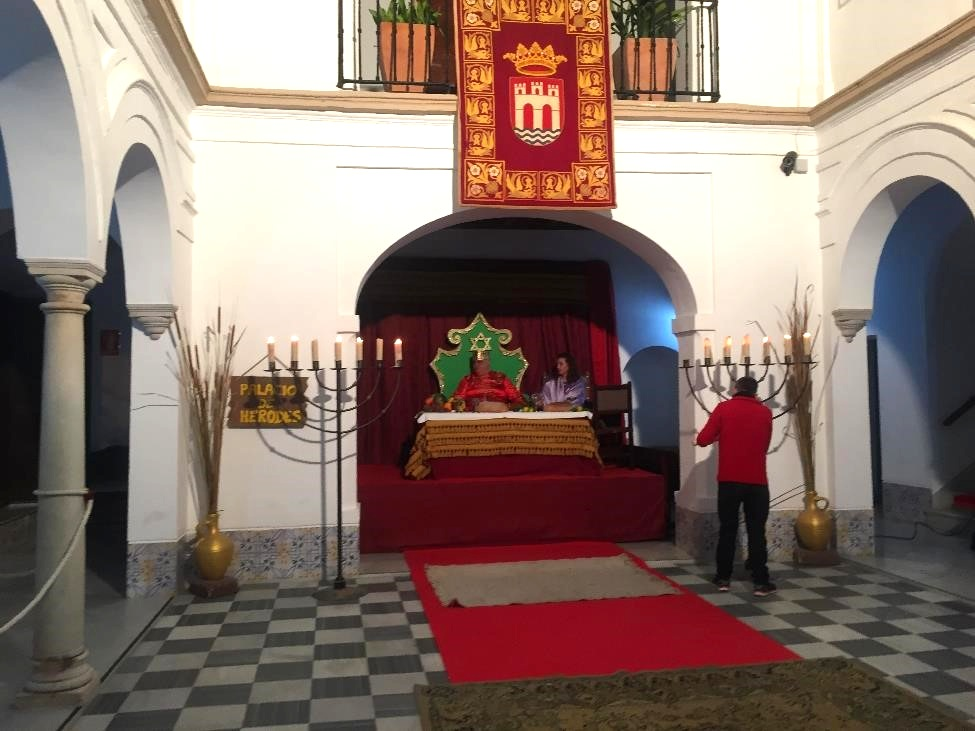 King Herod feasting in his castle. In the room next door, children could sit on the laps of the Three Kings, who are the gift givers to children in Spain.