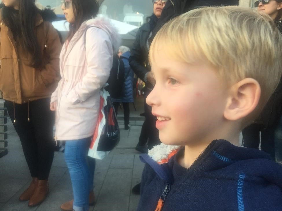 Henry particularly enthralled with a street dance show. Look at that face.