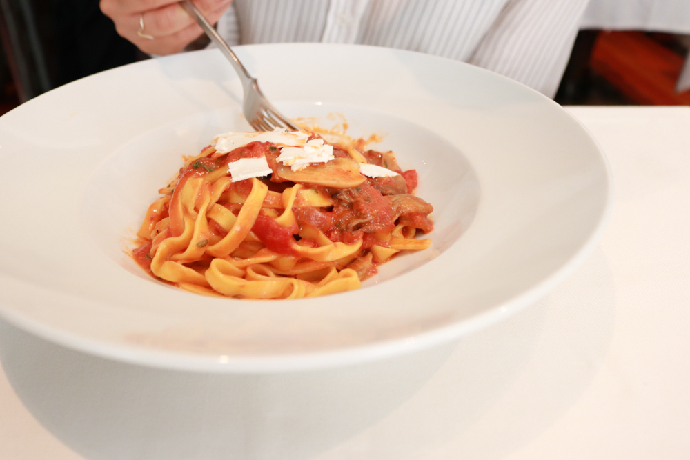 Pappardelle,  housemade pasta ribbons, mushroom, tomato, ricotta salata
